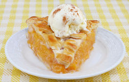 Peach Pie Ala Mode Front View. One slice of peach pie ala mode, front view stock photography
