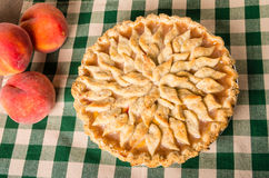 Peach pie with decorated crust Stock Images