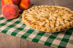 Peach pie with decorated crust Royalty Free Stock Photo
