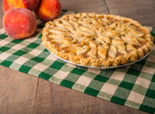 Peach pie with decorated crust Stock Image