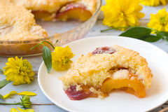 Peach pie. Decorated with flowers Royalty Free Stock Photography