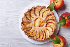 Peach pie and fresh fruit on a wooden top view Royalty Free Stock Photography