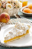 Peach pie with meringue topping Stock Photos