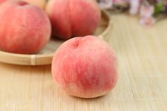 Peach. It is a peach piled to the basket stock image