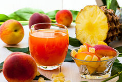 Peach and pineapple smoothie Stock Images