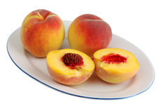 Peach on the plate. Isolated on white background Stock Photography