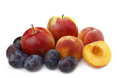 Peach,plums and apple royalty free stock photography