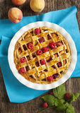 Peach and raspberry pie Stock Photography