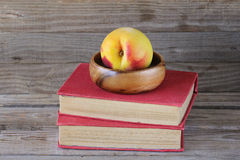 Peach on red books Stock Photos