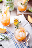 Peach and rosemary fizz cocktail Stock Image