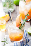 Peach and rosemary fizz cocktail Royalty Free Stock Photos