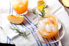 Peach and rosemary fizz cocktail on a wooden background. Cocktail. Stock Photography