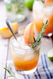 Peach and rosemary fizz cocktail on a wooden background. Cocktail. Stock Photo