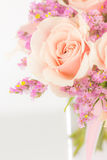 Peach roses and statice in a vase Royalty Free Stock Photos