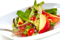 Peach salad with salad greens Stock Images