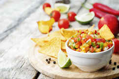 Peach salsa. On a light wood background. the toning. selective focus royalty free stock photography