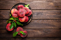 Peach, saturn or donut peaches with leaves Royalty Free Stock Photography