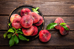 Peach, saturn or donut peaches with leaves Royalty Free Stock Images