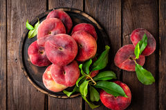 Peach, saturn or donut peaches with leaves Stock Photo