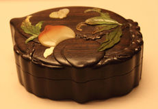 Peach-shaped sandalwood box Stock Images