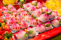 Peach shaped steam bun Stock Photos