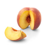 Peach with a slice cut out Royalty Free Stock Photography