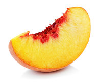 Peach slice isolated on white. Slice of ripe peach fruit isolated on white background. Peach slice with clipping path Royalty Free Stock Photo