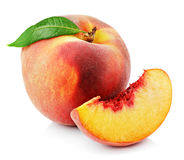 Peach with slice and leaf isolated on white Stock Photography