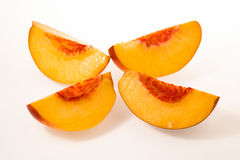 Peach sliced on four Stock Photography