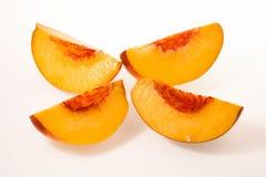 Peach sliced on four Stock Photography