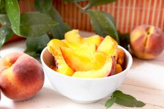 Peach slices. Bowl with peach slices and mint, healthy fruits stock photo