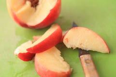 Peach with slices cut Stock Photos