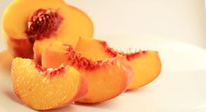 Peach slices. Fresh peach slices on a plate Stock Images