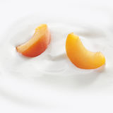 Peach slices laying in yogurt Stock Photos