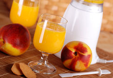 Peach smoothie in the glass Stock Images