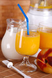 Peach smoothie in the glass Royalty Free Stock Photos