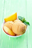 Peach sorbet with fresh fruit slices. Peach sorbet with fruit slices and mint in bowl Royalty Free Stock Photography