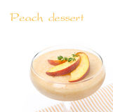 Peach souffle in glass, isolated on white, close-up Royalty Free Stock Photos
