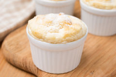 Peach souffle in the portioned form on a wooden board, close-up Stock Photo