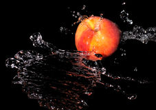 Peach in spray of water Royalty Free Stock Image