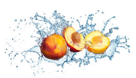 Peach in spray of water. Stock Photo