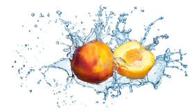 Peach in spray of water. Royalty Free Stock Photo