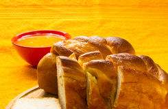 Peach strudel with natural honey. In a red bowl on a bright yellow textile background Stock Image