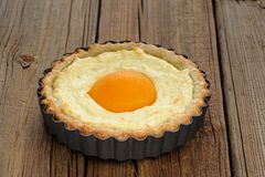 Peach tart with creamy filling on wooden background Stock Photos