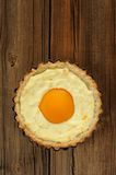 Peach tart with creamy filling on wooden background Royalty Free Stock Image
