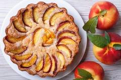 Peach tart and fresh fruit closeup top view Royalty Free Stock Photos