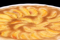 Peach tart in a white pottery cake tin Stock Photography