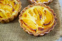 Peach tartlet individual pastry royalty free stock images