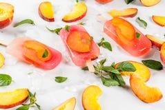 Peach tea popsicles Stock Photo