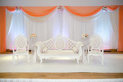 Peach themed wedding stage. Peach themed indian wedding stage royalty free stock photos